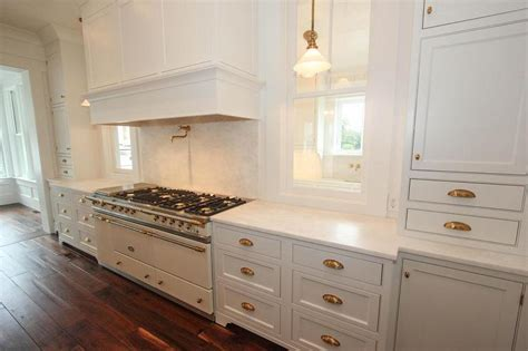 White Kitchen with White Lacanche Range   Transitional