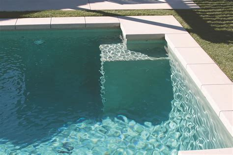 waterline pool tile ideas soft green colour at the waterline matched with the soft
