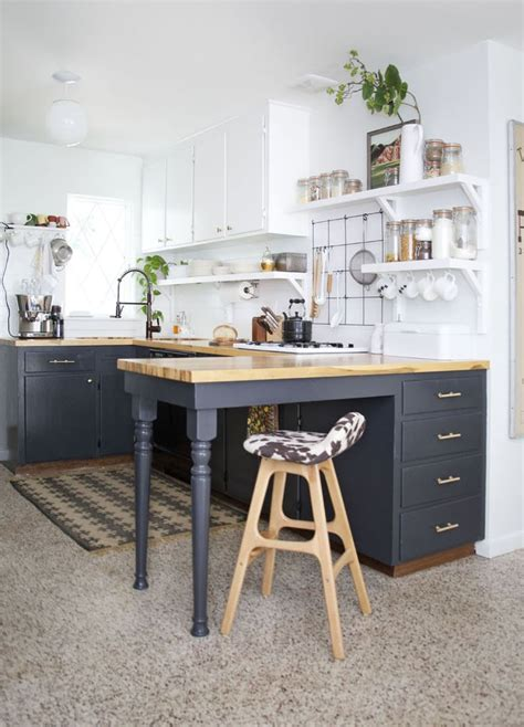 White marble cabinets, a magenta runner, blooming florals, and ladylike details give this galley kitchen gorgeous personality, while strategically placed mirrors make the small space feel larger. Small Kitchen Ideas   Photos   POPSUGAR Home Australia