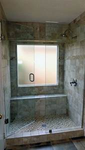 tile bathroom design with glass shower door and tub to With windows for bathroom showers