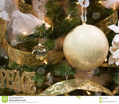 white and gold christmas tree ornaments royalty free stock