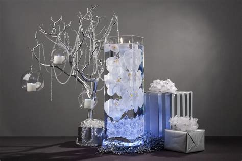 white floral centerpiece  led lights  floating candles