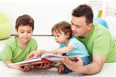 family literacy lifelong learning across generations 478   Father Kids Reading Fotolia 41470841 Nagy BagolyIlona