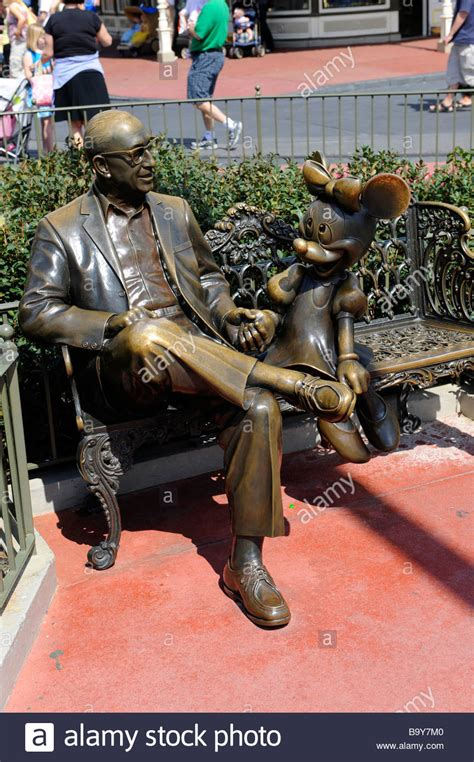 Walt Disney Bench by Statues Of Roy Disney With Minnie Mouse On Park Bench At