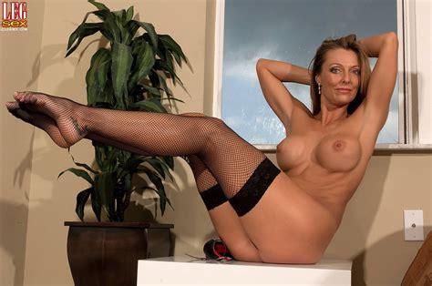 Brenda James Slowly Peels Her Sexy Black Stockings Off Of