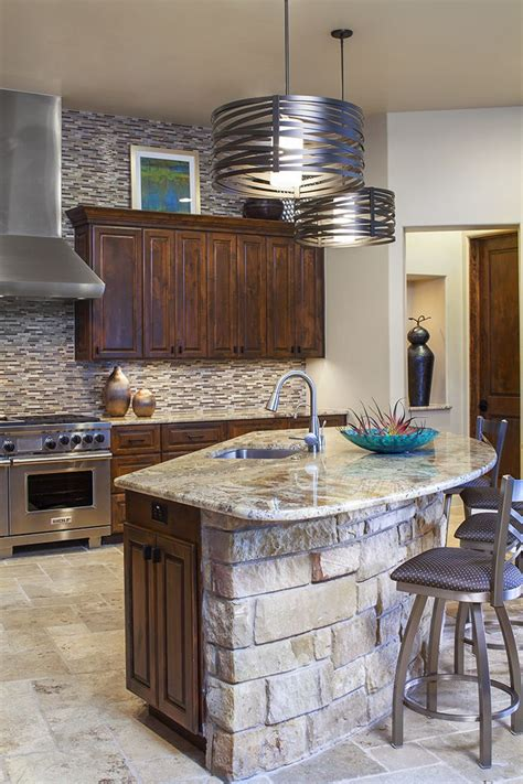 island in the kitchen a unique curved island with a rock facade and contemporary