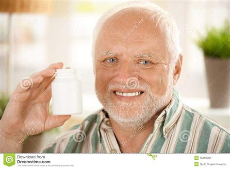 Happy Senior Man Holding Medication Stock Photography