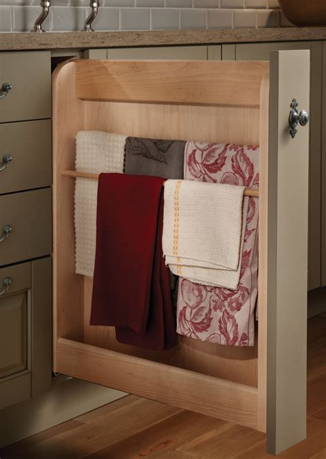 pull out her cabinet pull out towel cabinet wood mode fine custom cabinetry