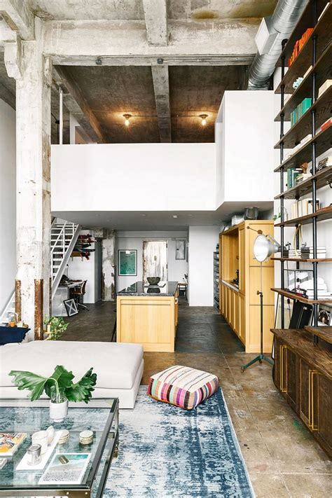 kitchen island with shelves loft with aged brick concrete floors and