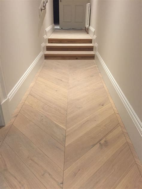Chevron parquet engineered wood flooring in hallway and 3