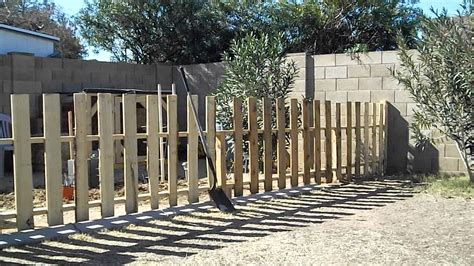How To Build Backyard Fence by How To Build A Garden Fence Using Reclaimed Pallets