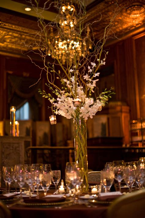 tall curly willow and dendrobium orchid centerpiece