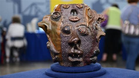 grotesque face jug ca  corrected antiques