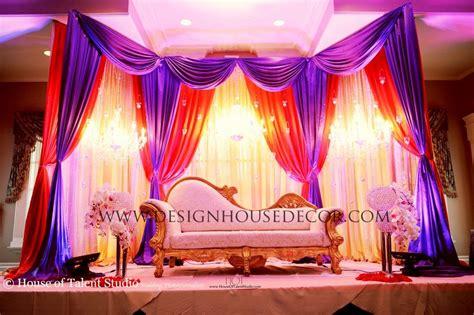 reception stage decor show decorator purple red stage