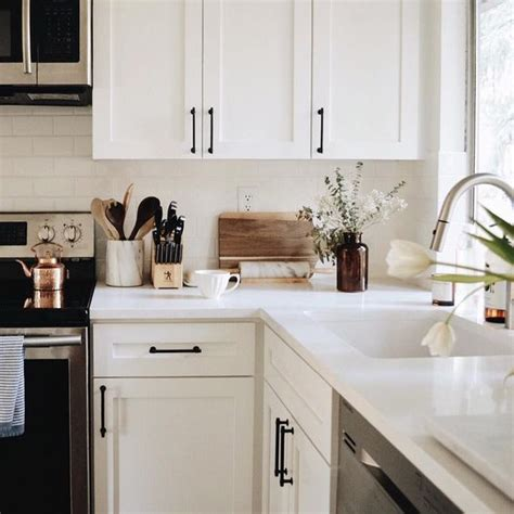 black kitchen cabinet handles white cabinets with black hardware the everygirl