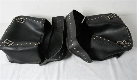 Vintage Black Leather Rivets Throw Over Motorcycle