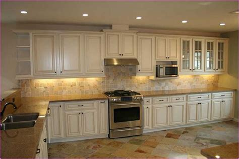 Distressing Kitchen Cabinets by How To Paint Distressed Kitchen Cabinets Loccie Better