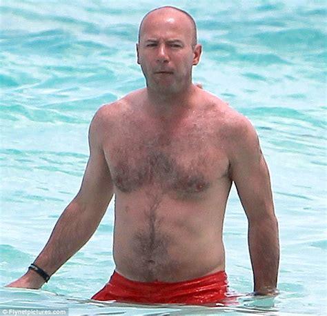 Former England footballer Alan Shearer's balding head is ...