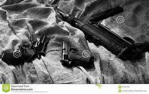 Guns On Bed Sheet. Film Noir Style. Revolver, Pistol ...