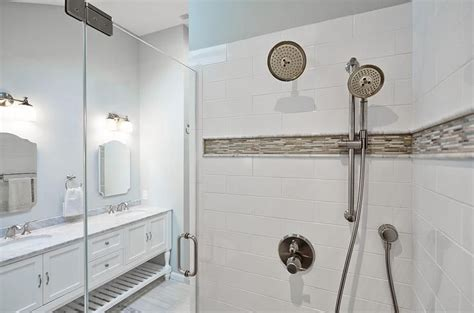 Mosaic Border Tiles Bathrooms by Master Bathroom Shower Boasts White Subway Tiles Accented