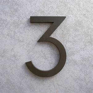 modern house numbers in bronze With bronze letters and numbers