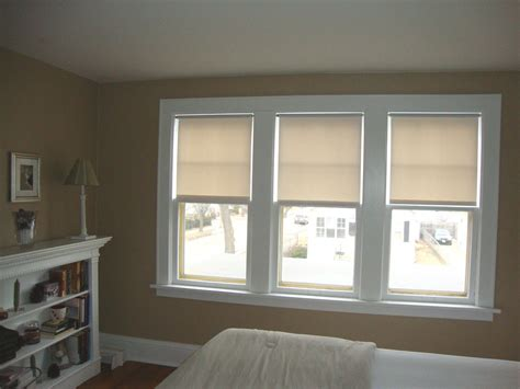 curtains for kitchen window above white triple single hung window completed with
