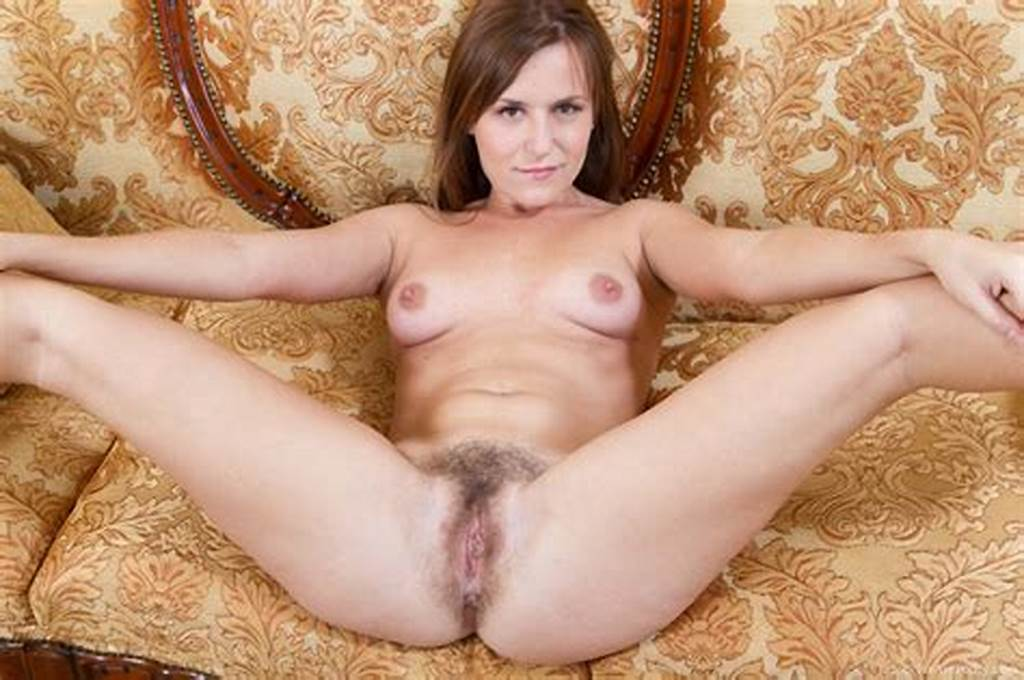 #Hairy #Woman #Era #Is #Sitting #On #Her #Yellow #Couch #In #The