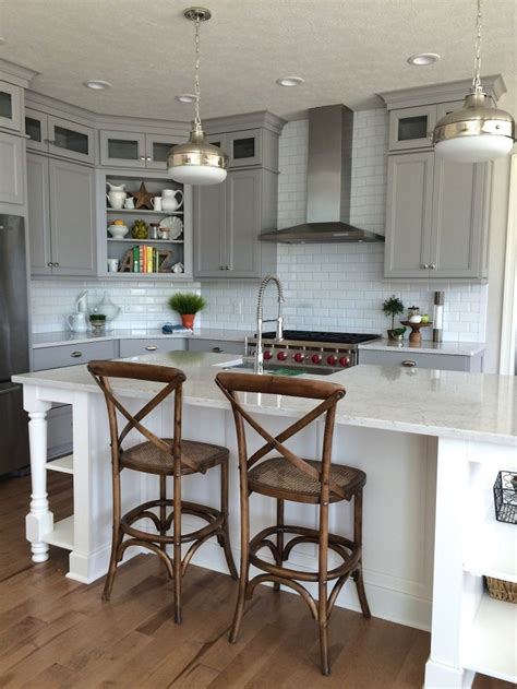 how to add color to a kitchen gray and white kitchen perimeter cabinets in dove gray by 9279