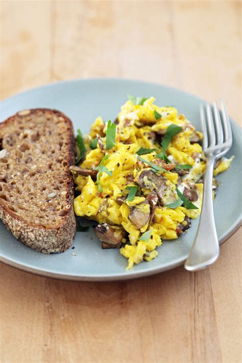 scramble cuisine scrambled eggs with mushrooms and goat cheese popsugar food