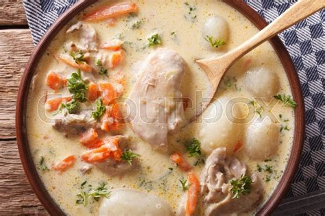 Belgian Ghent WATERZOOI soup with chicken close up in a