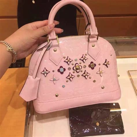 louis vuitton monogram vernis alma flower bag reference