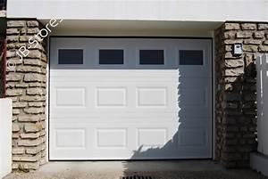 porte de garage sectionnelle refoulement plafond avec hublots With porte de garage sectionnelle avec fenetre