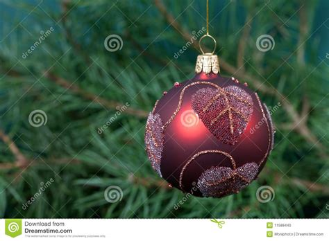 big christmas baubles and garland on dark stock photo