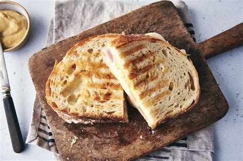 Combination of idaho ham and roast turkey with swiss cheese on sourdough bread.… combination of bell pepper, cucumber, carrots, tomato and onions with swiss cheese on sour…… $8.00. Ham and Cheese Panini | King Arthur Flour