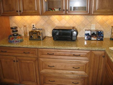 how to install a kitchen cabinet on the wall signature kitchen bath st louis tumbled marble backsplash 9909