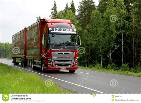 red volvo truck red volvo fh16 truck on summer highway editorial