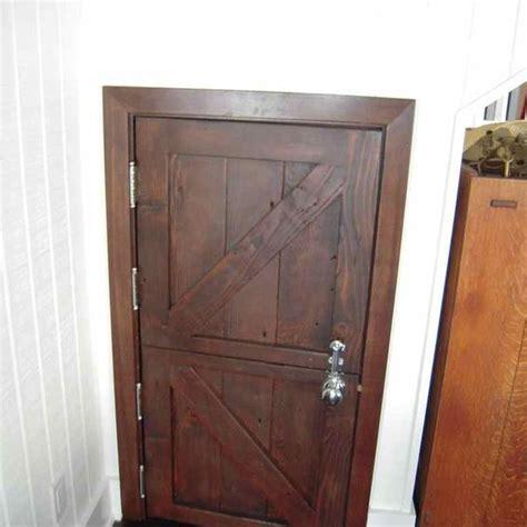 made custom reclaimed wood bi fold closet doors for a