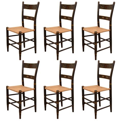 a set of six american stenciled hitchcock style chairs at