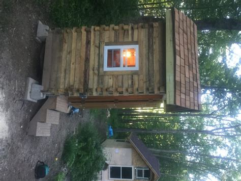 tiny cabin built  recycled pallets