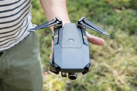 dji s new mavic pro drone folds up and fits in the palm of your the verge