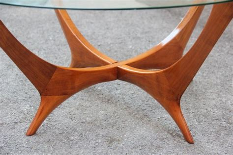 Supported by angled solid american walnut, rich brass details support the craftsmanship and beauty of real wood. Italian Coffee Table Round Cherry Wood Glass Top Mid-Century Modern 1950s For Sale at 1stdibs