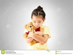 Sad Little Girl Hugging Teddy Bear Alone Stock Photo ...
