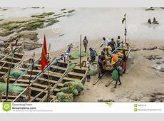 Local Residents Near The Fishing Boat In Ghana Editorial
