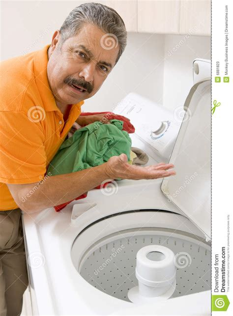 doing laundry by man doing laundry stock photos image 6881823