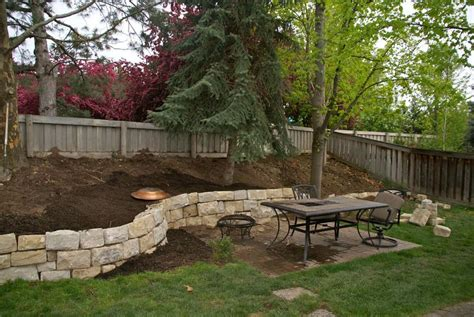 backyard retaining wall retaining walls for sloped backyards sloped hill in our backyard by putting up a sand stone