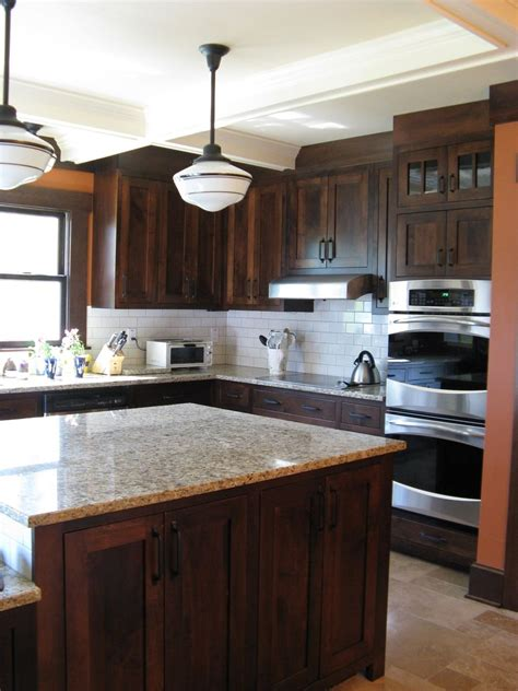 It is meant to protect the walls from staining, especially in the zones close to your sink and stove, the places where you cook, clean, and prepare food. 50+ Modern Walnut Kitchen Cabinets Design Ideas - Decoratoo