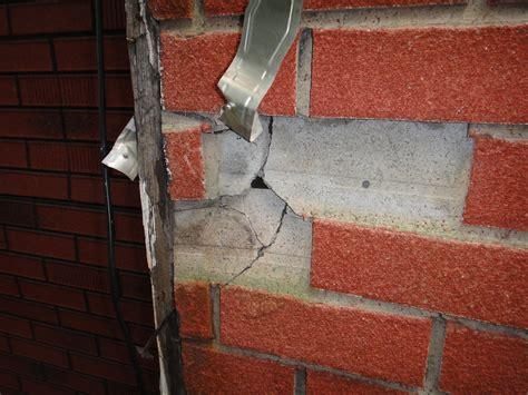 damaged asbestos cement fake brick house siding