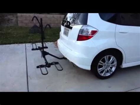 Added a hitch and dual bike rack to my fit hondafit. SportRack Bicycle Rack on my 2011 Honda Fit Sport - YouTube