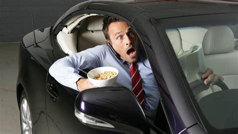 eating  driving  dangerous   car