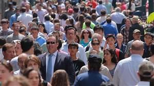 Crowd of people walking on city street sidewalk slow ...